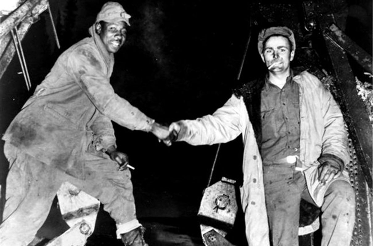 Image of black and white American soldiers shaking hands